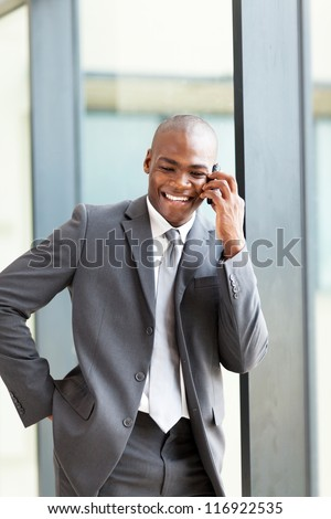 happy african american business executive talking on cell phone - stock photo
