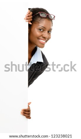 Happy African American business woman hiding behind banner isolated on white background - stock photo