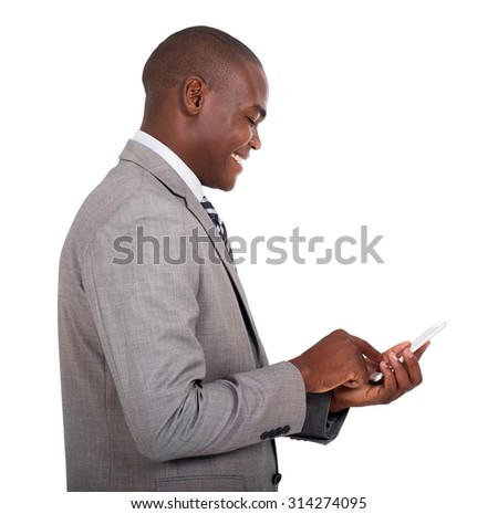 happy african american businessman texting on his smart phone - stock photo