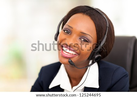 happy african american call center operator with headphones - stock photo
