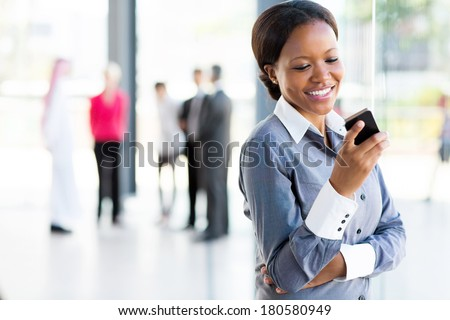 happy african american career woman using cell phone - stock photo