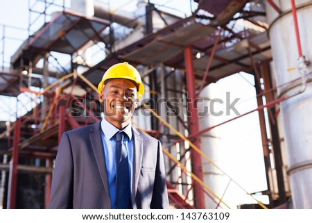 happy african american chemical industry manager in plant - stock photo
