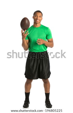 Happy African American College Student Tossing Football on Isolated White Background - stock photo