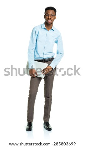 Happy african american college student with laptop standing on white background