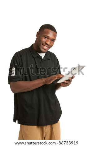 Happy African American College Student Working on Touch Screen Tablet PC - stock photo