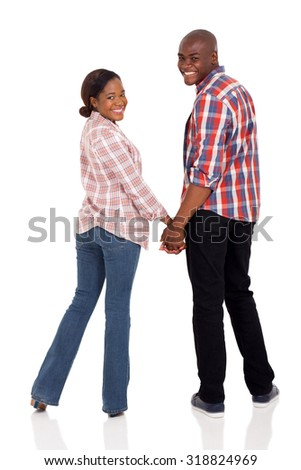 happy african american couple holding hands and looking back isolated on white - stock photo