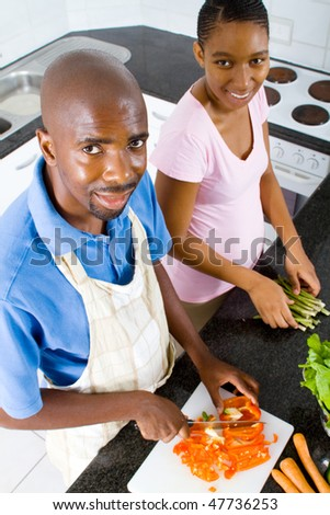 happy african american couple in kitchen