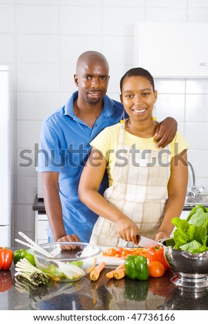 happy african american couple portrait in kitchen