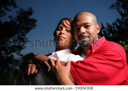 Happy African American couple together outdoors, close-up. - stock photo