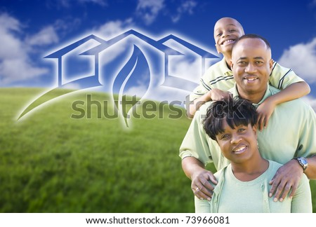 Happy African American Family and Green House Graphic in Grass Field. - stock photo