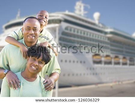 Happy African American Family in Front of Cruise Ship. - stock photo