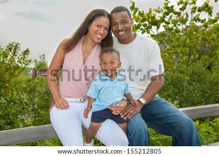 Happy African American Family Outdoor In Summer Sunny Day - stock photo