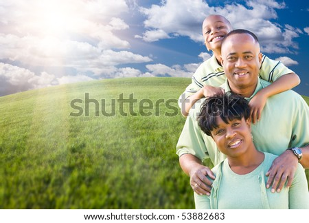 Happy African American Family Over Clouds, Sky and Arched Horizon of Grass Field. - stock photo