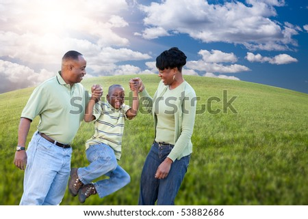 Happy African American Family Playing Over Clouds, Sky and Arched Horizon of Grass Field. - stock photo