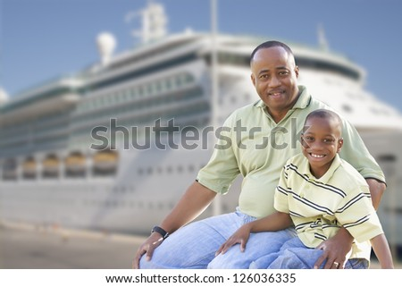 Happy African American Father and Son in Front of Cruise Ship. - stock photo