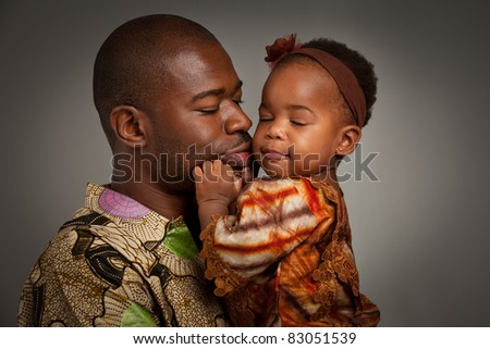 Happy African American Father Holding Baby Girl Portrait Isolated on Grey Background - stock photo