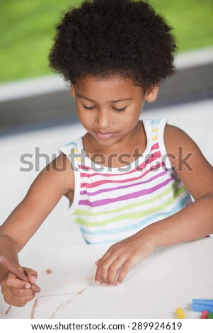 Happy african american girl drawing - stock photo
