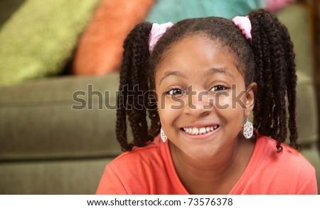 Happy African American girl in her room - stock photo