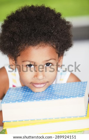 Happy african american girl with books - stock photo