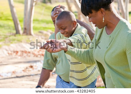 Happy African American Man, Woman and Child Having Fun in the Park. - stock photo