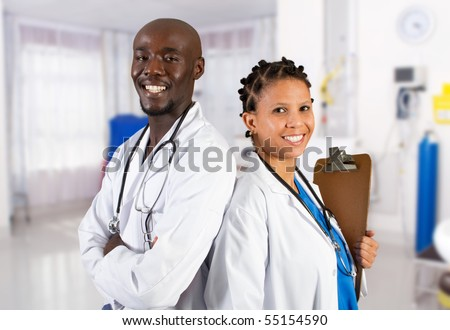 happy african american medical professionals in hospital ward