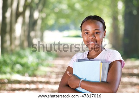 happy african american university student outdoors - stock photo