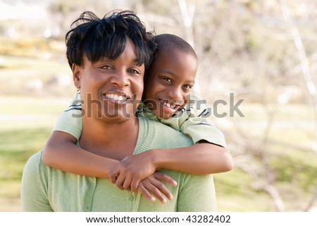 Happy African American Woman and Child Having Fun in the Park. - stock photo