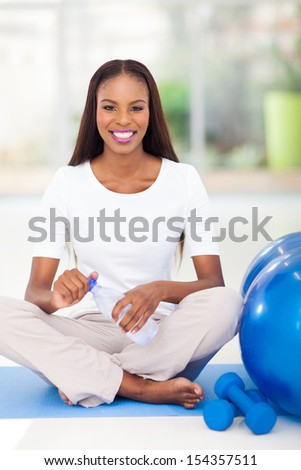 happy african american woman drinking water after working out - stock photo