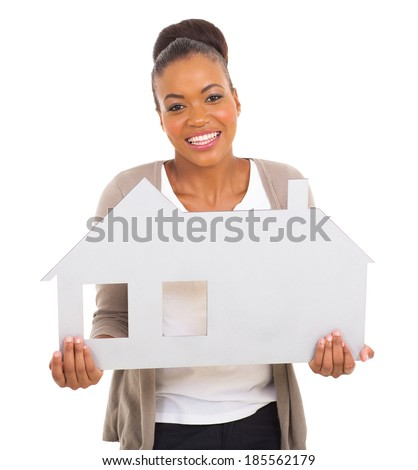 happy african american woman holding white house symbol - stock photo
