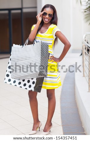happy african american woman in shopping center - stock photo
