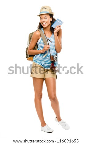 Happy African American woman tourist holding passport - stock photo
