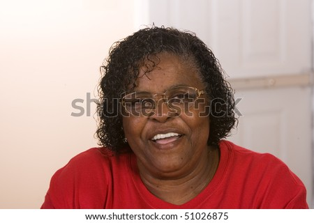 Happy African American Woman wearing glasses smiling. - stock photo