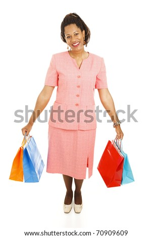 Happy african-american woman with her shopping bags.  Full body isolated on white