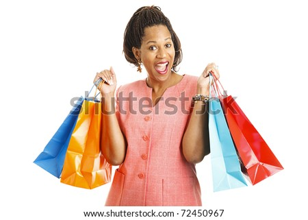Happy african-american woman with shopping bags.  Isolated on white.