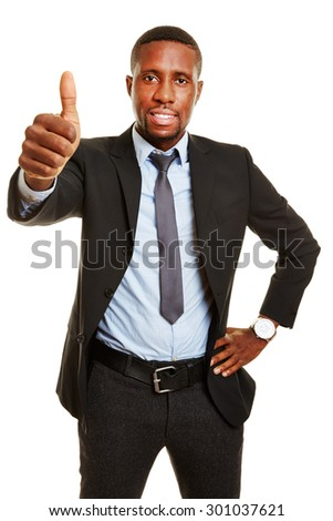 Happy african business man holding his thumbs up - stock photo