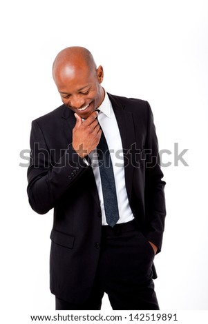 Happy African business man looking down shot on an isolated background - stock photo