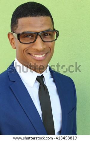Happy african businessman in a blue suit - stock photo