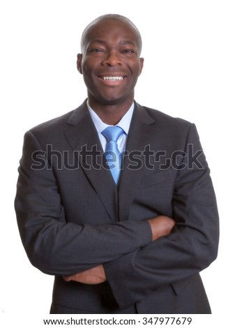 Happy african businessman in a dark suit - stock photo