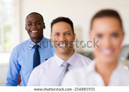 happy african businessman standing in a row with colleagues