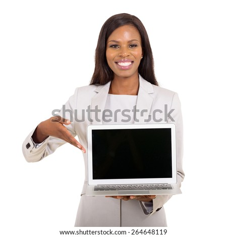 happy african businesswoman presenting black laptop screen on white background - stock photo