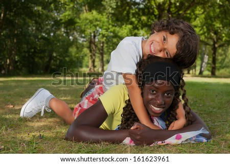 Happy african children having a nice dat at the park  - stock photo