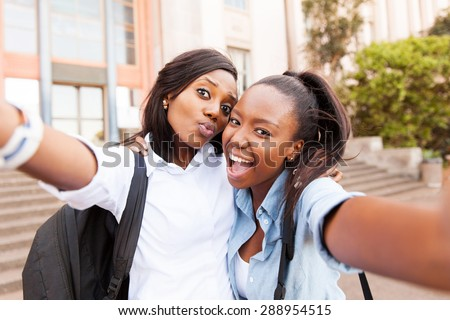 happy african college friends taking selfie together  - stock photo