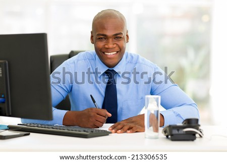 happy african corporate worker working in office - stock photo