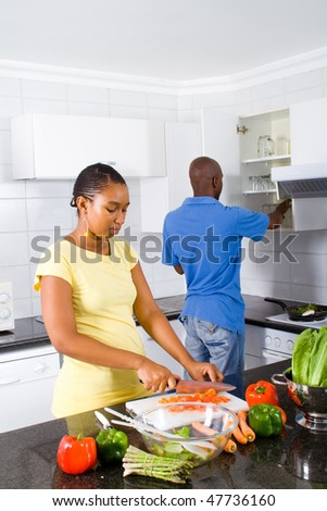 happy african couple in kitchen