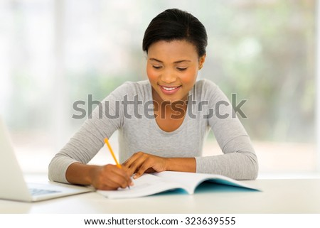 happy african female college student studying  - stock photo