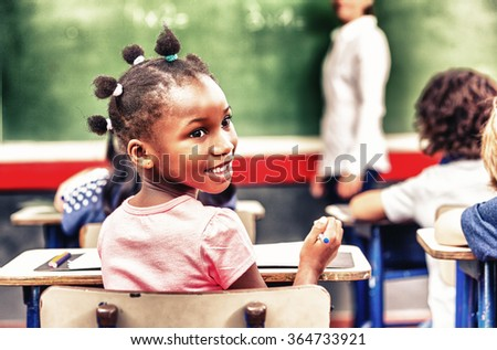 Happy african girl at elementary school. Success concept.