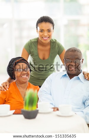 happy african grandparents and granddaughter at home - stock photo