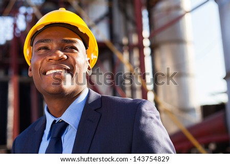 happy african industrial manager at oil refinery plant