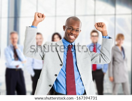 Happy african manager and his team - stock photo
