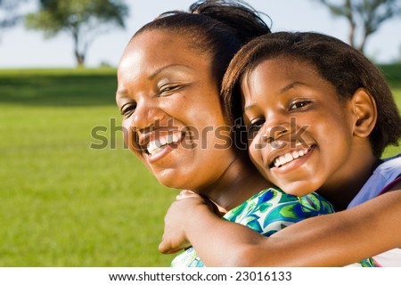 happy african mother and daughter together - stock photo